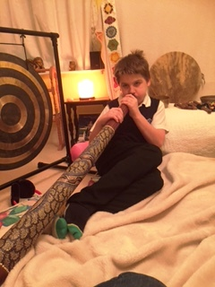 12 year old with digeridoo at his sound healing session